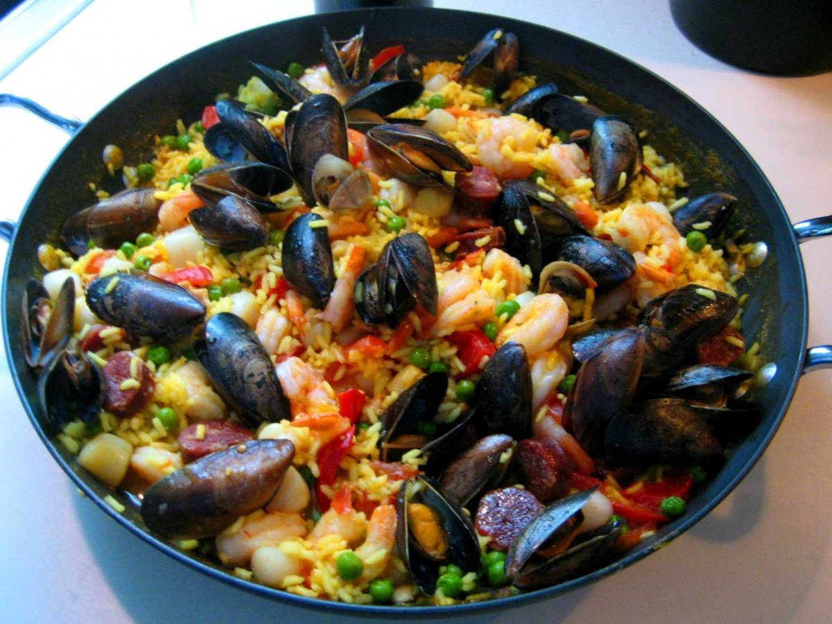 share-a-pot-of-paella-saffron-infused-rice-with-seafood-and-chorizo-with-friends-at-famed-can-maj-a-restaurant-on-the-beach-in-barcelona-spain