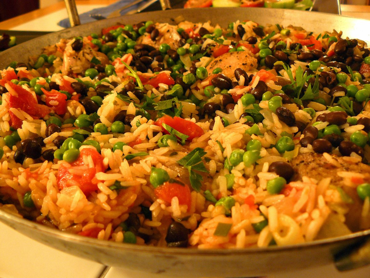 stuff-yourself-with-a-hearty-and-flavorful-meal-of-arroz-con-pollo-rice-mixed-with-chicken-vegetables-and-black-beans-in-havana