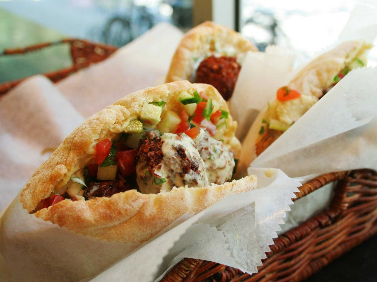 take-a-bite-out-of-a-crispy-chewy-fresh-falafel-sandwich-overstuffed-with-vegetables-in-amman-jordan-falafel-al-quds-and-abu-staif-are-famous-falafel-shops